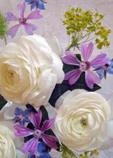 centro mesa flores rosas malvas borrajas